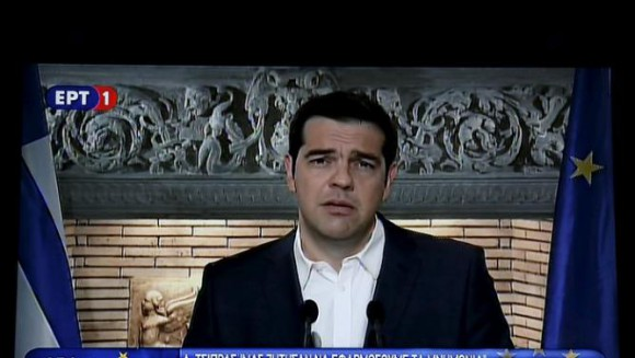 Greek Prime Minister Alexis Tsipras is seen on a television monitor whille addressing the nation early June 27, 2015. REUTERS/Pool